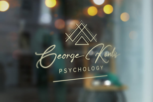 Window decal signage for George Kontis Visual Identity